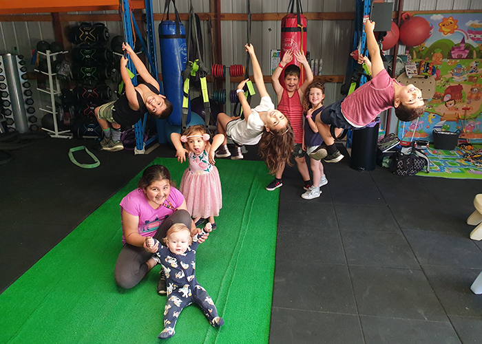 Exercise for kids programs near Melbourne - group of kids in fitness studio getting active