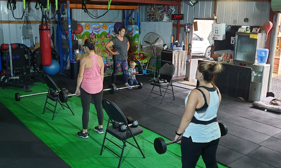 Group fitness classes Melbourne - group of women working out in fitness studio