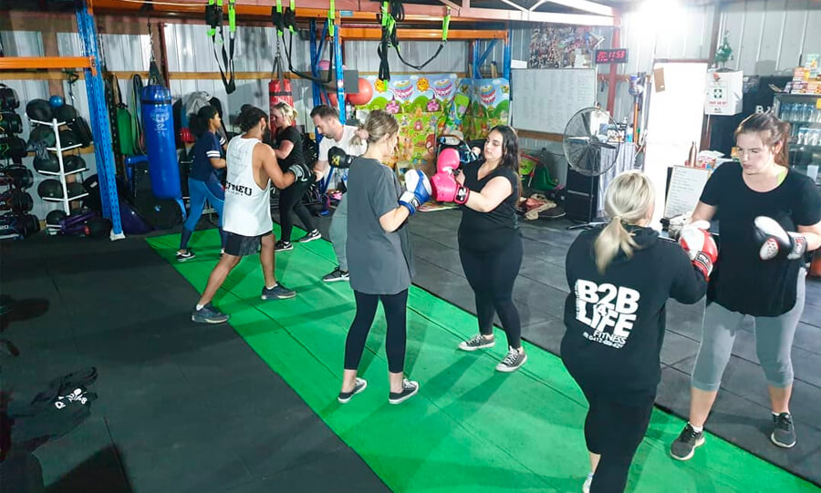 A group fitness class working together to do boxing in North Melbourne