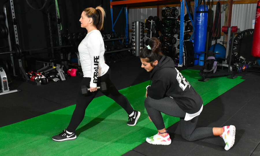 Woman working out with personal trainer Shadi in Melbourne exclusive studio